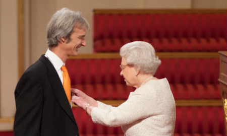 Andrew receives OBE from the Queen